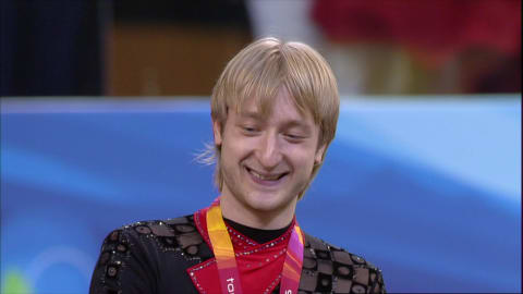 Plushenko upgrades to gold in Turin
