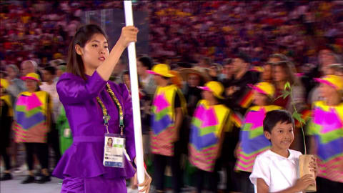 Flagbearer Sorn Seavmey leads out Cambodian athletes at Rio 2016