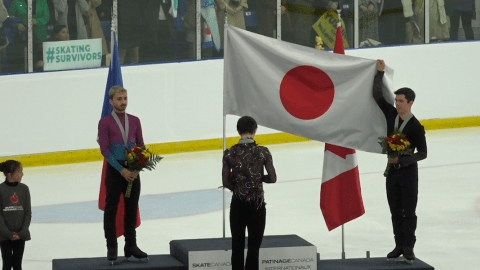 WATCH: Keegan Messing holds the Japanese flag for Yuzuru Hanyu