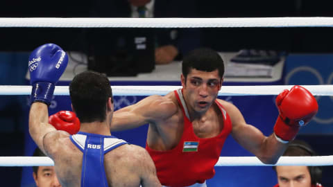 Zoirov too strong for Panghal in world flyweight final
