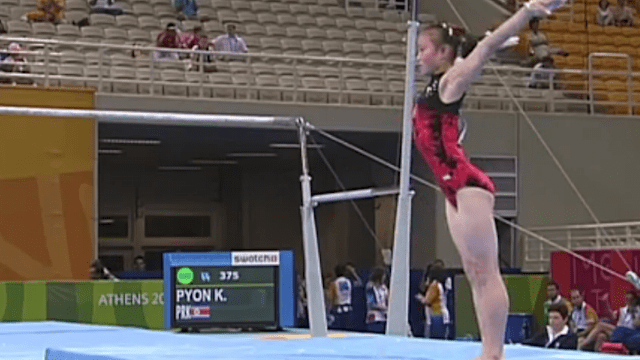 Pyon Kwang-Sun on the uneven bars during qualifications at Athens 2004