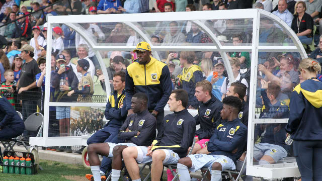 Usain Bolt stands during Central Coast's A-League trial match with Newcastle