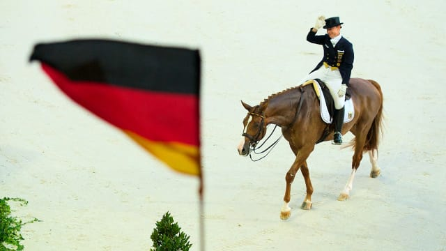 Isabell Werth celebrates winning the dressage title on Bella Rose at the FEI World Equestrian Games 2014 in Normandy, France.