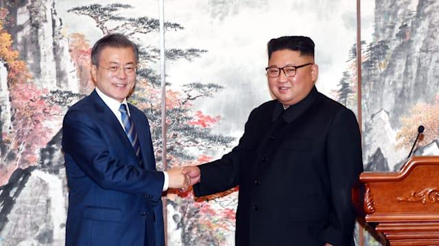 South Korean President Moon Jae-in and North Korean leader Kim Jong Un shake hands after meeting in Pyongyang on 19 September 2018.
