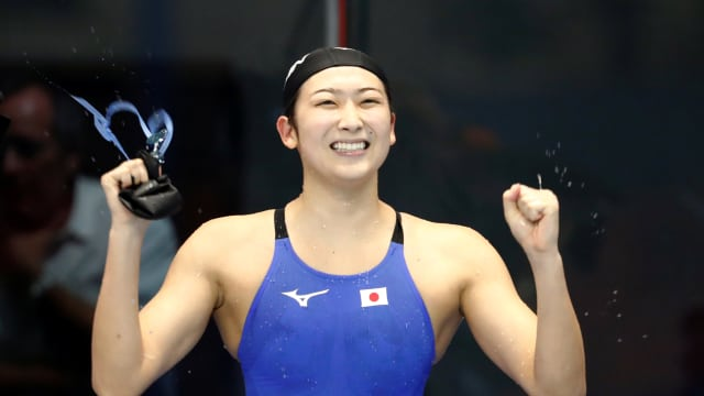 Rikako Ikee celebrates victory in the 50m freestyle for her sixth title at the Asian Games in Jakarta