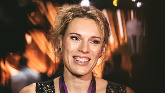 Austra Skujyte speaks to the media after receiving her London 2012 bronze medal