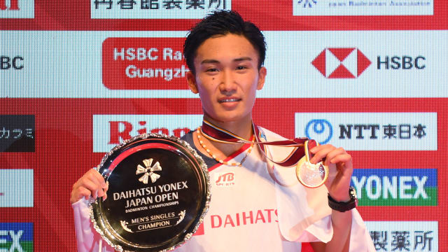 Kento Momota poses with his trophy and medal after winning the Japan Open in September