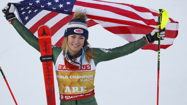 Mikaela Shiffrin celebrates after winning her fourth consecutive world slalom title in Are, Sweden