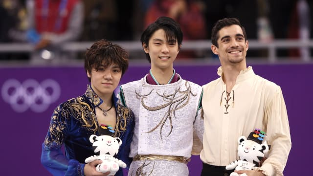 Javier Fernandez on podium after winning medal