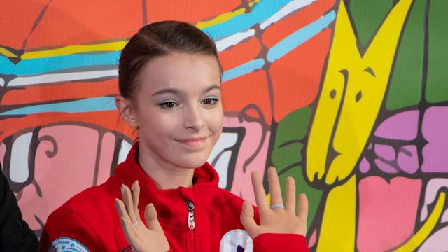 World Junior Championship runner-up Anna Shcherbakova waves to the crowd in Zagreb