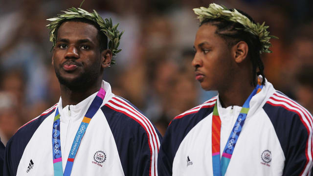 LeBron James and Carmelo Anthony of the USA react on the podium after receiving their men's basketball bronze medals at the Athens 2004 Olympic Games. (Photo by Jamie Squire/Getty Images)