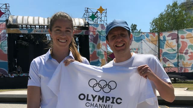 Sarah Walker holds Olympic Channel Podcast t-shirt