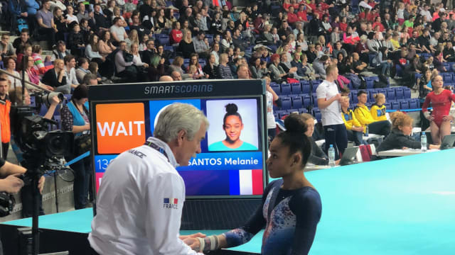 Melanie De Jesus Dos Santos having a world with her coach Eric Hagard