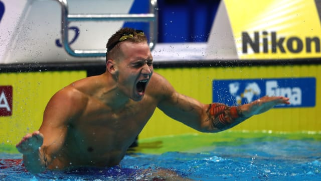 Caeleb Dressel celebrates gold in the 100m freestyle at the 2017 World Aquatics Championships in Budapest