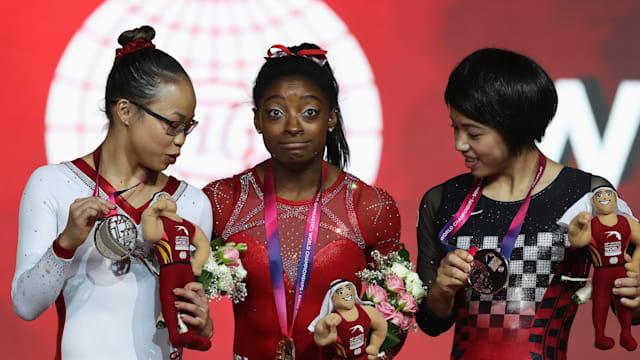 Women's floor podium (L-R): runner-up Morgan Hurd, winner Simone Biles, third-placed Mai Murakami