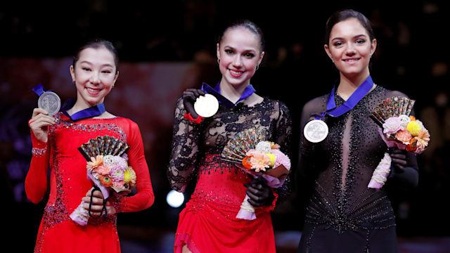 Silver medallist Elizabet Tursynbaeva, gold medallist Alina Zagitova, and bronze medallist Evgenia Medvedeva pose on the podium after the Ladies' Free Skate. (REUTERS/Issei Kato)