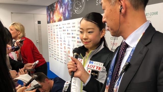 Rika Kihira in the mixed zone after her short program