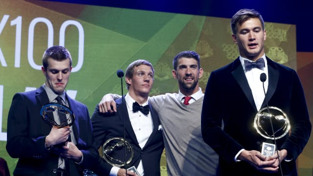 Nathan Adrian makes an acceptance speech after winning relay of the year award during the 2016 Golden Goggle Awards with teammates, Ryan Held (L), Caeleb Dressel, and Michael Phelps on November 21, 2016 in New York City. (Photo by Jeff Zelevansky/Getty Images)