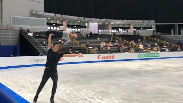 Morgan Cipres lifts Vanessa James during pairs practice at the Worlds.