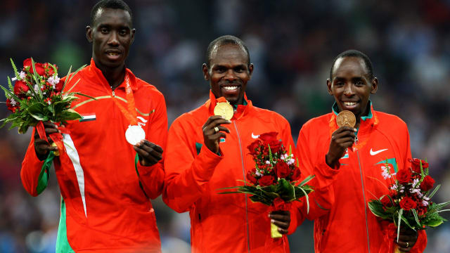 Wilfred Bungei (centre) with his Olympic gold medal