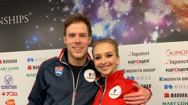 Victoria Sinitsina and Nikita Katsalapov of Russia pose after scoring a personal best in the rhythm dance