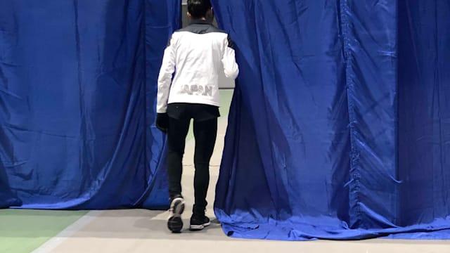 Satoko Miyahara looks through some curtains