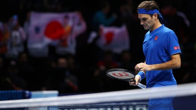 Roger Federer reacts after he loses his match to Kei Nishikori