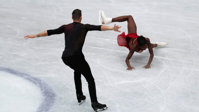 Vanessa James falls on an attempted throw triple flip during the pairs short program.