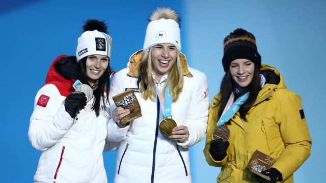 (L to R) Silver medalist Anna Veith of Austria, gold medalist Ester Ledecka of Czech Republic and bronze medalist Tina Weirather of Liechtenstein celebrate during the medal ceremony for the Ladies' Alpine Skiing Super-G at the PyeongChang 2018 Winter Olympic Games
