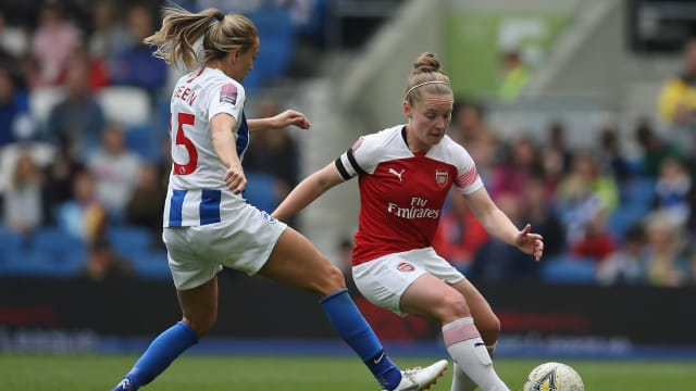 Kim Little in action for Arsenal against WSL rivals Brighton