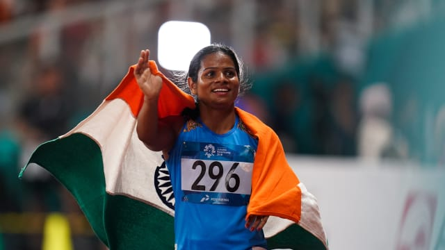 Dutee Chand on the podium after coming second in the 100m final at the Asian Games on August 26, 2018 in Jakarta, Indonesia. (Photo by Lintao Zhang/Getty Images)