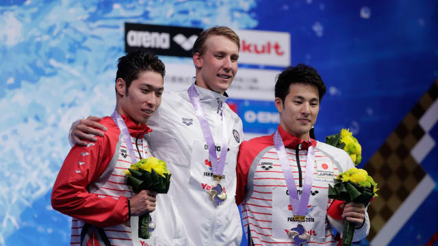 Kosuke Hagino in 2nd, Chase Kalisz 1st and Daiya Seto 3rd on the Men's 400m Individual Medley podium at the Pan Pacific Swimming Championships in Tokyo, August 9, 2018. (Photo by Kiyoshi Ota/Getty Images)