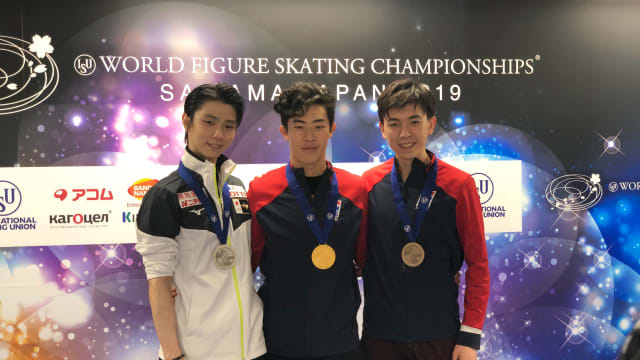 Yuzuru Hanyu, Nathan Chen, and Vincent Zhou pose with their medals