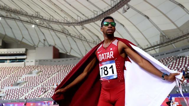 Abderrahman Samba celebrates after winning the 400m hurdles at the 2019 Asian Athletics Championships in Doha