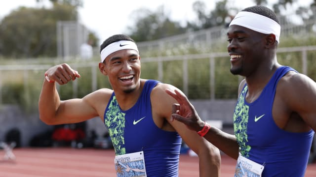 Michael Norman celebrates with Rai Benjamin after the 400m at the Mt SAC Relays in Torrance, California on 20 April