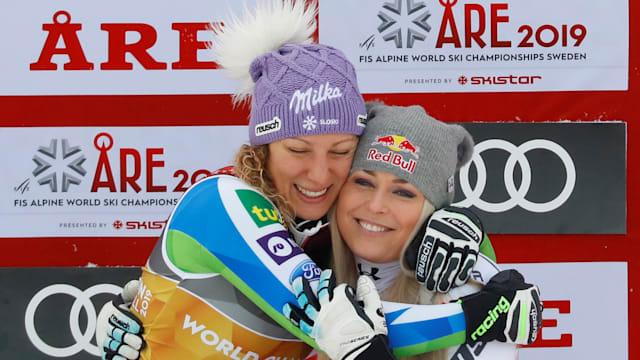 World downhill champion Ilka Stuhec hugs bronze medallist Lindsey Vonn in Are, Sweden