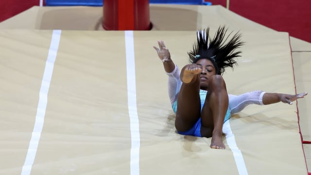Simone Biles falls as she tries to land her 'Biles' vault in the world all-around final in Doha