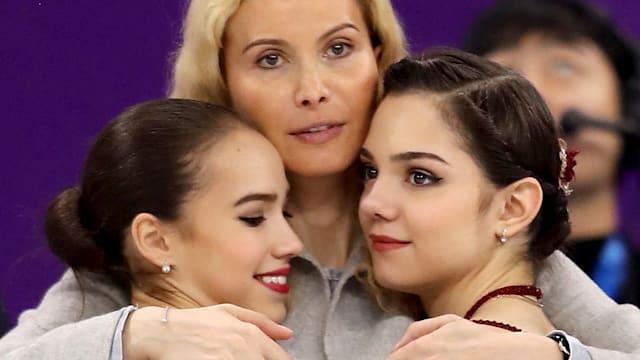 Alina Zagitova (L) and Evgenia Medvedeva (R) with Eteri Tutberidze at PyeongChang 2018