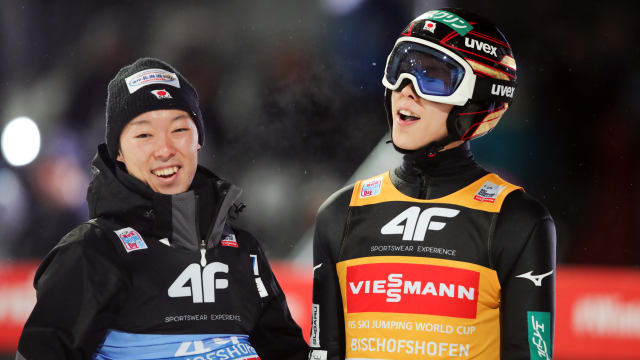Ryoyu Kobayashi reacts with brother Junshiro after his second jump at Bischofshofen