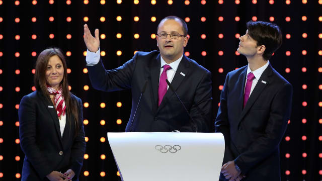 Virginie Faivre, Patrick Baumann and Stephane Lambiel at the 128th IOC Session in Kuala Lumpur on July 31, 2015