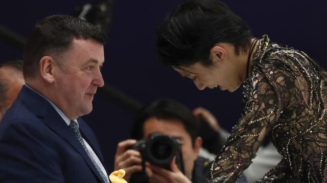 Yuzuru Hanyu with coach Brian Orser after his free skate at the Rostelecom Cup