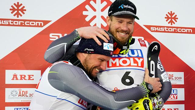 Runner-up Aksel Lund Svindal (L) hugs winner Kjetil Jansrud after the World Championship downhill at Are