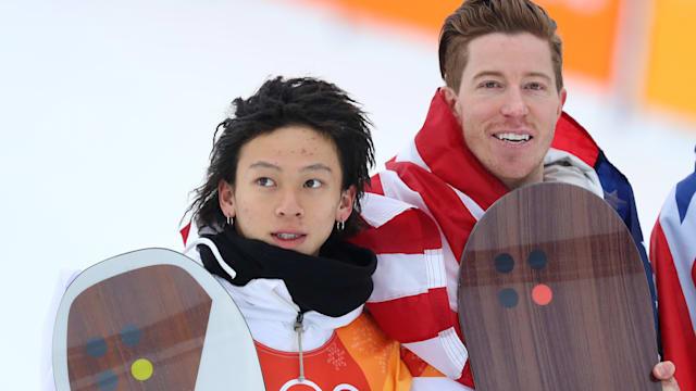 Snowboard halfpipe silver medallist Ayumu Hirano and winner Shaun White on the podium at PyeongChang 2018