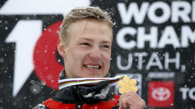 Dmitry Loginov celebrates winning the parallel slalom, his second gold at the 2019 Snowboarding World Championships in Utah