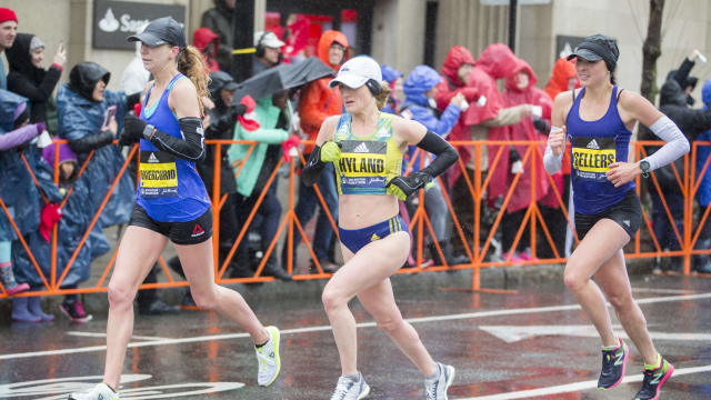 Sarah Sellers (right) competes at the 2018 Boston Marathon