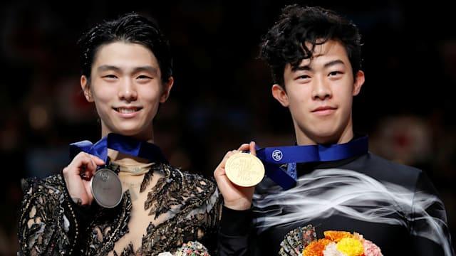 2019 world champion Nathan Chen (R) with silver medallist Yuzuru Hanyu in Saitama