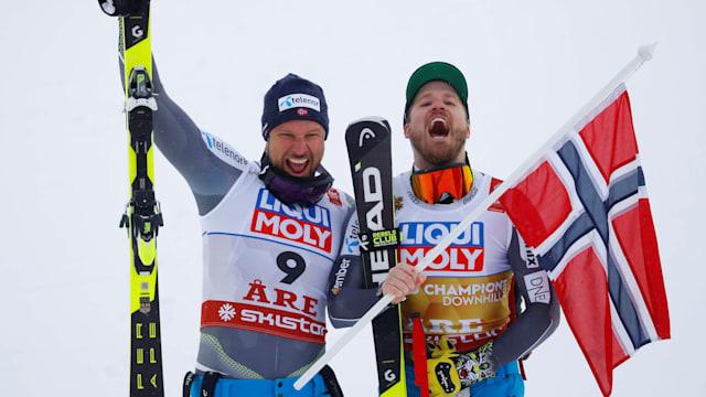 Runner-up Aksel Lund Svindal celebrates with champion Kjetil Jansrud after the World Championship downhill in Are, Sweden