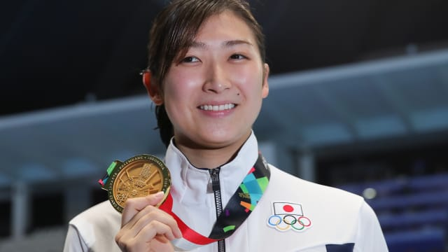 Rikako Ikee poses after winning her sixth Asian Games title in Jakarta