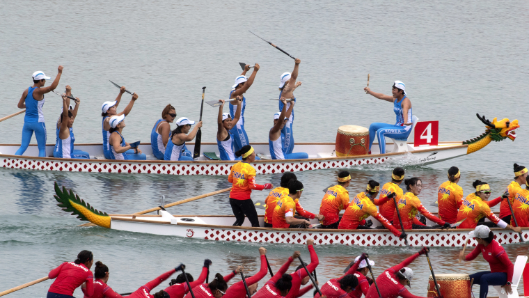 Unified Korea (top) wins the Asian Games 500m women's dragon boat race from China and Thailand
