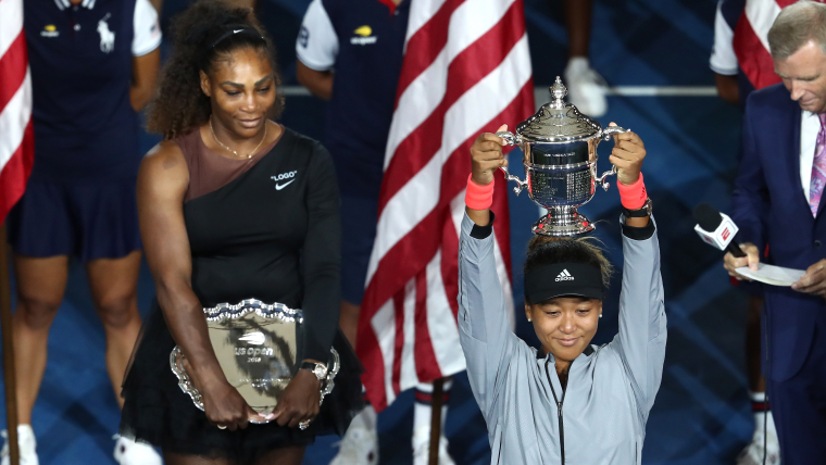 Naomi Osaka of Japan poses with the championship trophy after winning the 2018 US Open Women's Singles final against Serena Williams of the United States. (Photo by Al Bello/Getty Images)